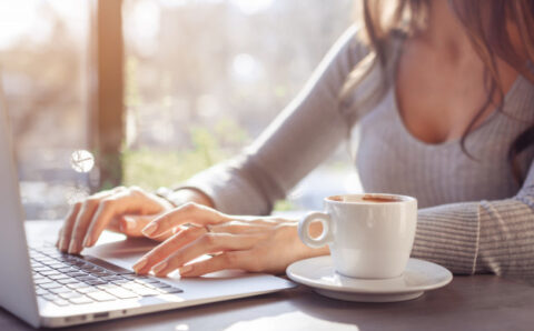 a-girl-is-working-at-a-laptop-in-a-cafe-on-a-sunny-day_77190-881